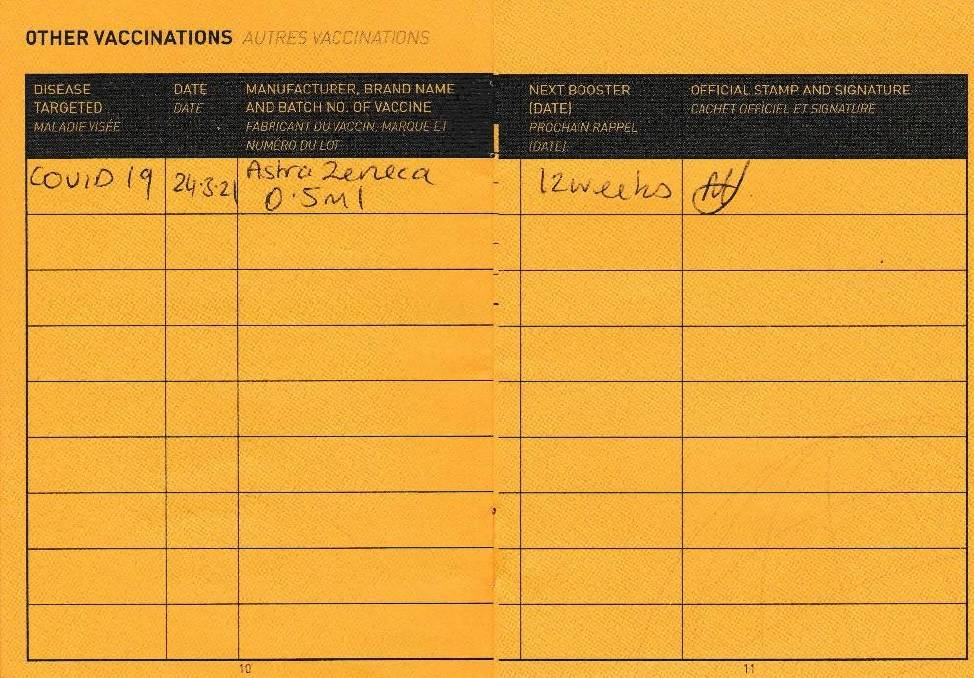 A card showing when John May received his first dose of the AstraZeneca vaccine.