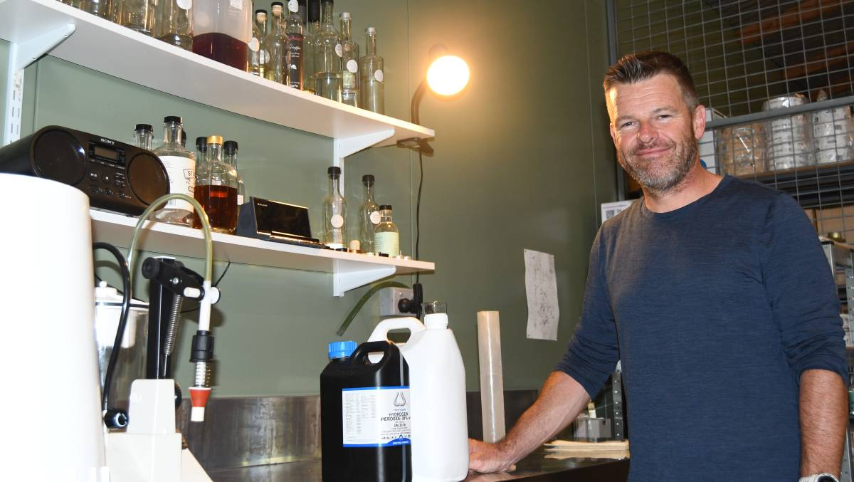 FREE TO A GOOD HOME: Bathurst distiller Ian Glen with some of the ethanol, glycerol and hydrogen peroxide he used to make hand sanitiser.