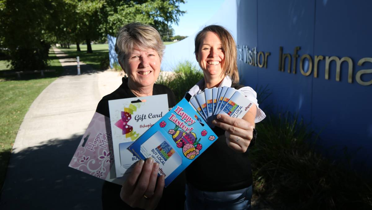 SUCCESS STORY: Wendy Grundy and Melinda Hadley with Buy Local Gift Cards at the Bathurst Visitor Information Centre. Photo: PHIL BLATCH