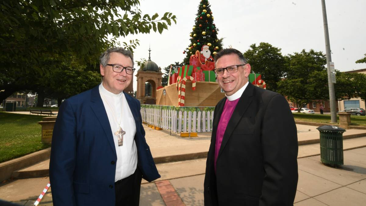PEACE ON EARTH: Catholic Bishop Michael McKenna and Anglican Bishop Mark Calder have shared their Christmas wishes. Photo: CHRIS SEABROOK