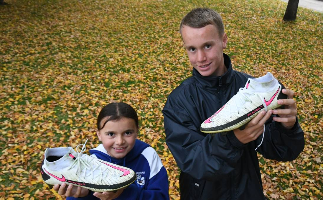 BEST BOOTS: Tahlia and Brayden Branda with the football boots they collected at Saturday's NRL clash. Photo: CHRIS SEABROOK