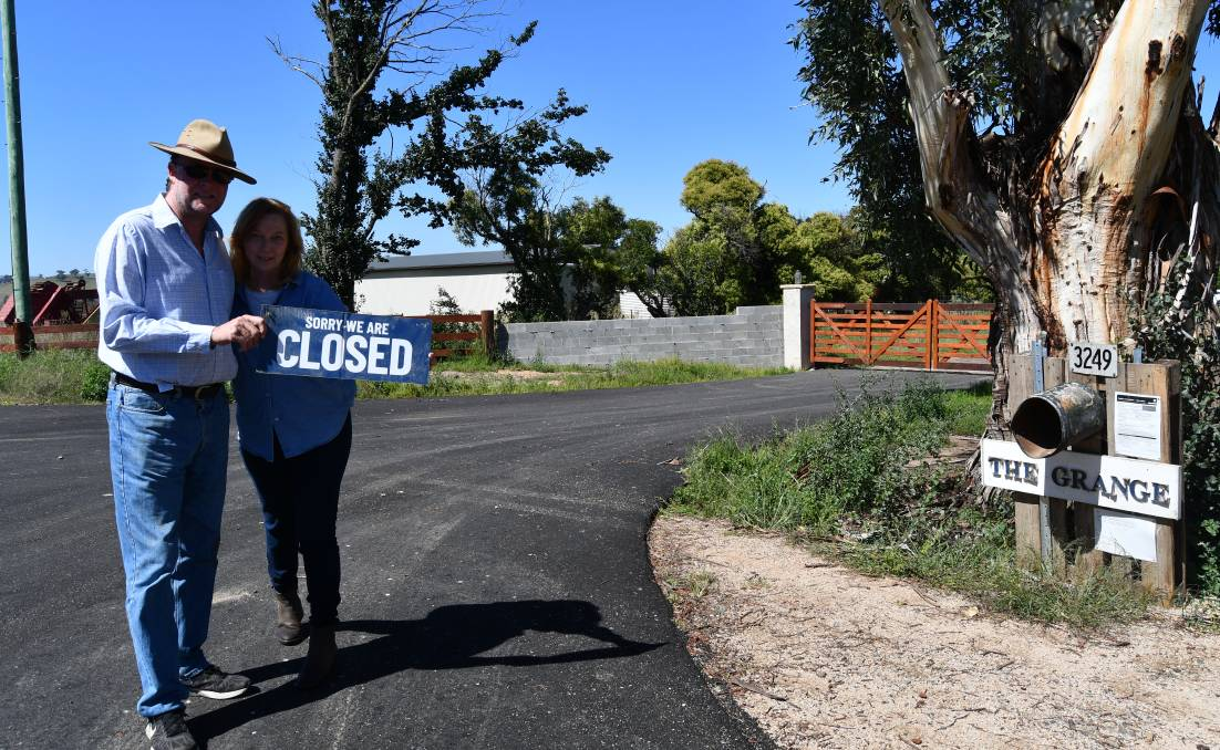 ROAD BLOCK: Toby and Sue Jones standing in the upgraded driveway of their property The Grange on O'Connell Road.