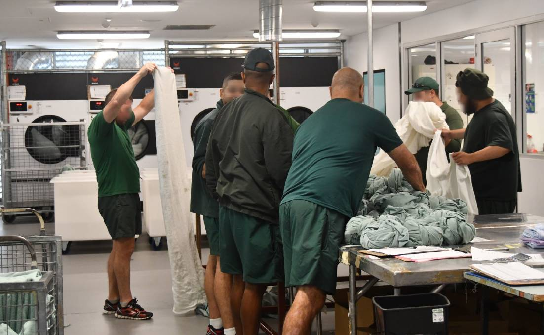 HARD AT WORK: Staff in Corrective Services Industries, Laundry Unit, wash thousands of sheets, blankets and clothing every day.