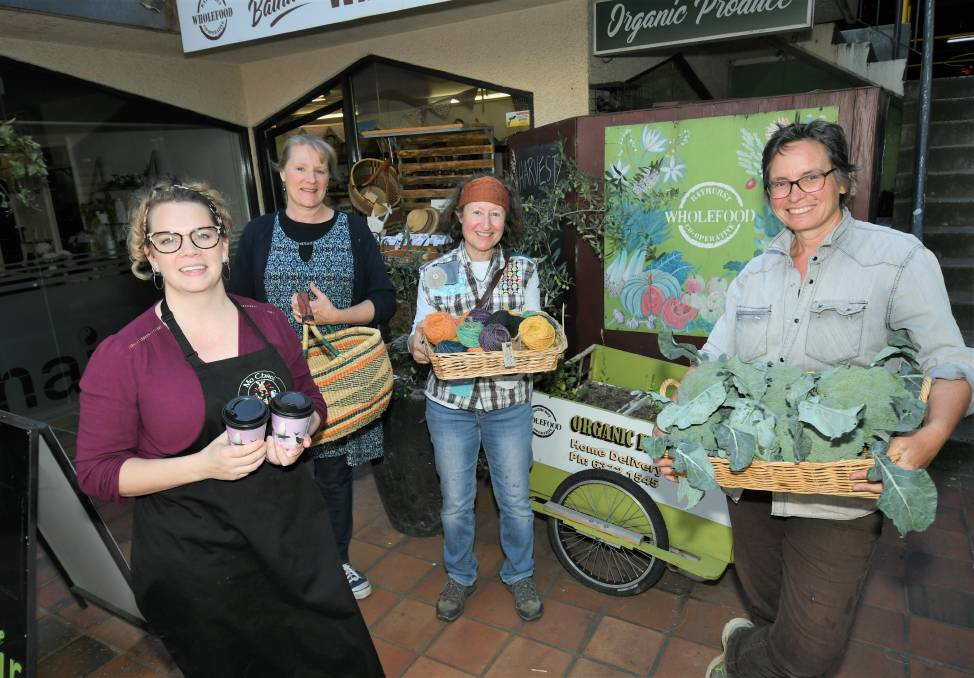 READY: Mo Chroi's Caitriona Cohen with stallholders Alice Jamieson, Fiona Howle and Cathie Hale. Photo: CHRIS SEABROOK 041421cwholefood