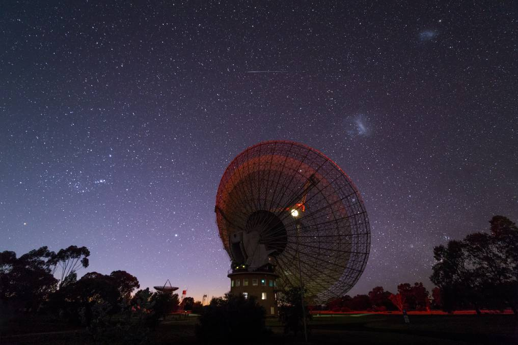 Eye on the sky: The Parkes Telescope in action is an amazing thing to witness, as are the heavenly bodies it keeps watch over. Photo: CSIRO.