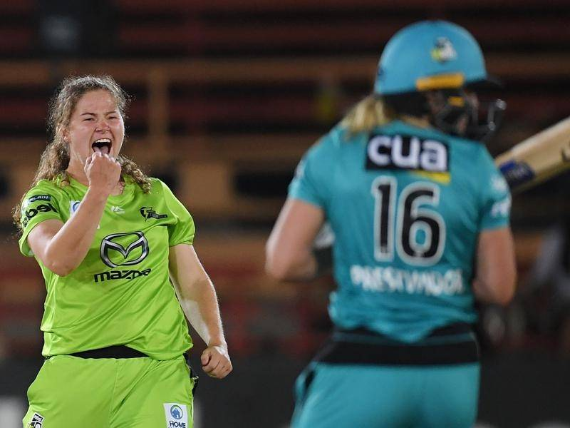 Thunder's Hannah Darlington celebrates the wicket of Heat's Georgia Prestwidge in the semi-final.