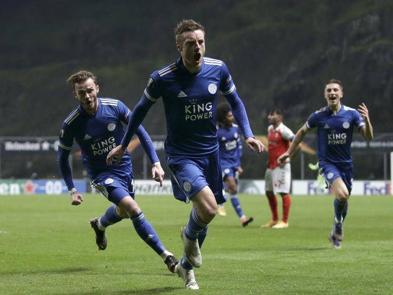 Jamie Vardy scored in time added on to take Leicester City to the next round of the Europa League.