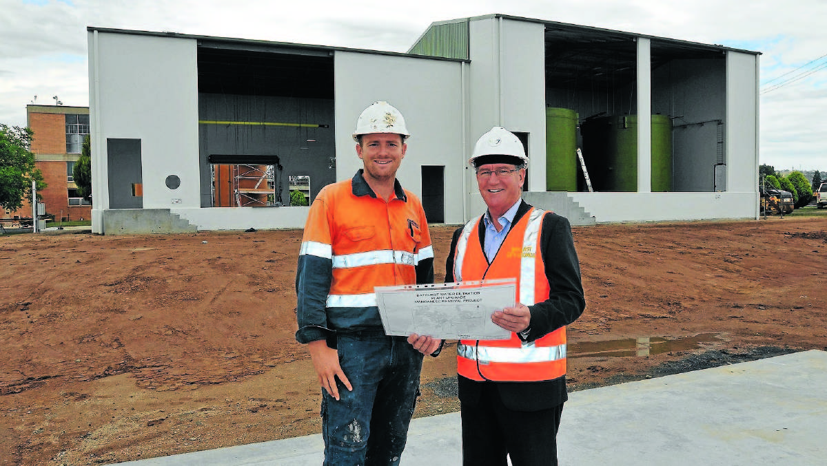 ON SCHEDULE: Eodo Pty Ltd's Jack Goddard with Bathurst mayor Gary Rush at the water filtration plant that is part of the $5 million Manganese Removal Project. Photo: BATHURST REGIONAL COUNCIL