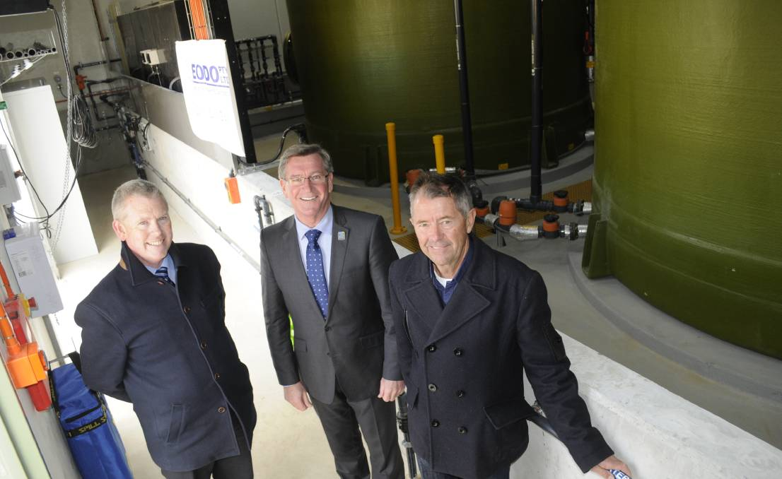 MONUMENTAL OCCASION: Bathurst Regional Council's manager of water and waste Russell Deans, left, Mayor Gary Rush and Bruce Goddard from EODO, inside the new plant that is expected to solve Bathurst's dirty water woes. Photo: CHRIS SEABROOK 080315cwater2