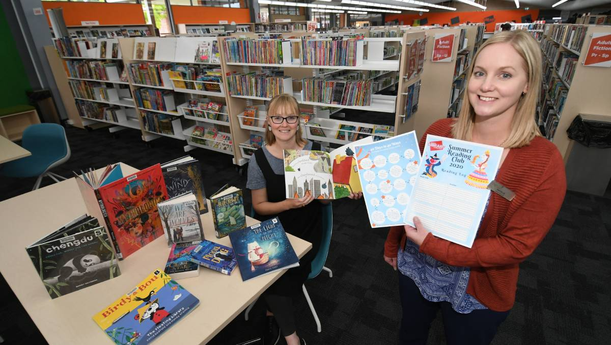 WELL READ: Bathurst Library staff Sarah Fleming and Natalie Conn promoting the Summer Reading Club. Photo: CHRIS SEABROOK